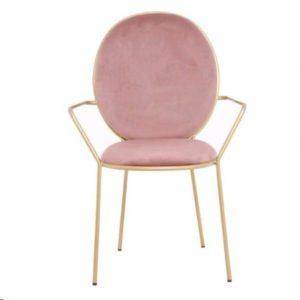 Chaise en velours rose avec accoudoirs